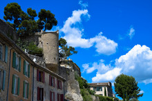 Remnants Of The Old City Walls And Turrets Of Menerbes, In The Luberon Area Of Provence, France