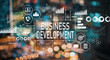 canvas print picture - Business development with blurred city abstract lights background