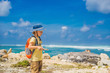 Boy traveler on amazing Melasti Beach with turquoise water, Bali Island Indonesia. Traveling with kids concept