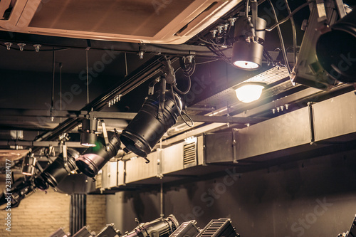Foto  Modern stage theater floodlights and projector illumination equipment