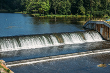 Old Dam At Ancient Hydroelectric Power Station, Water Flows
