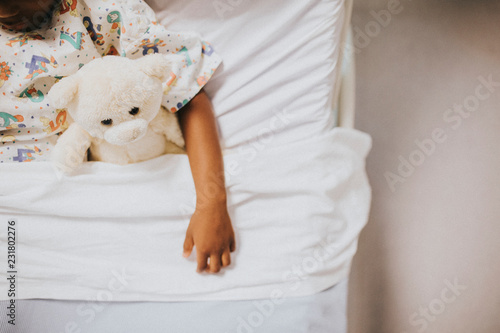 Little girl sleeping in a hospital bed Canvas Print