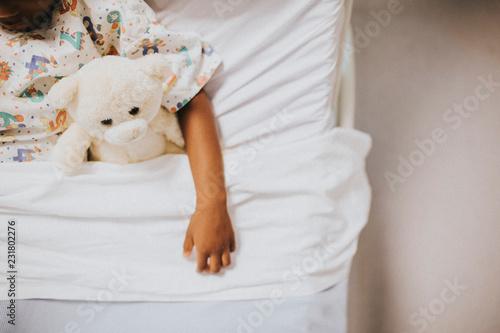 Little girl sleeping in a hospital bed Wallpaper Mural