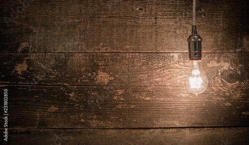 Fotografija edison vintage light bulb right landscape view with barn wood background
