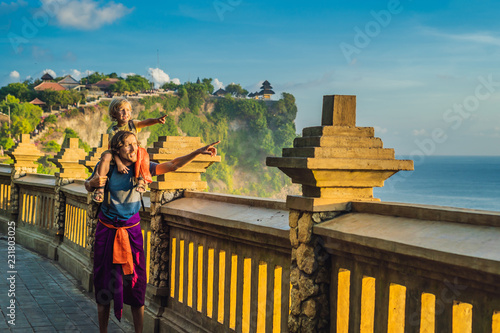 Dad And Son Travelers In Pura Luhur Uluwatu Temple Bali Indonesia Amazing Landscape Cliff With Blue Sky And Sea Traveling With Kids Concept Buy This Stock Photo And Explore Similar