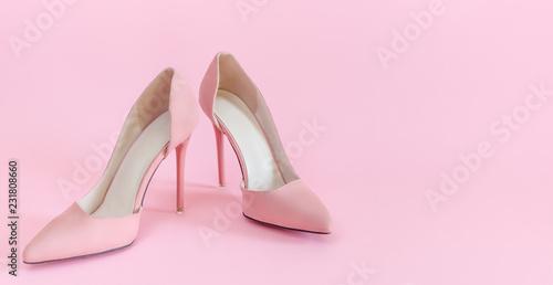 Valokuva Soft pink suede high heels on matching background