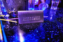 Reserved Sign On A Table At Night Club