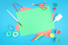 Color Paper In Blue, Pink And Green, Paint, Scissors And Other Colorful Stationery With Copy Space Top View Flat Lay