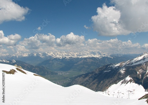 Spring Alps landscape with mountains and blue sky