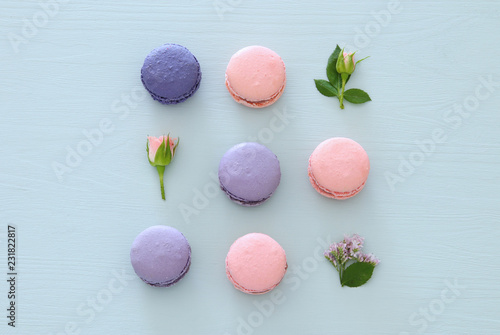 Fototapety, obrazy: Top view of colorful macaron or macaroon over pastel blue background. Flat lay.