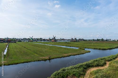 Wide panorama of Zaanse Schans Windmills. Peacefull countryside scene in Netherlands