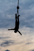 BERLIN, GERMANY - July 29, 2018: Sihluette Of A Male Bungee Jumper Against Dramatic Skies