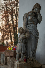 Statuette Woman With Child On The Background Of Lampshades On The Grave, Mystical Atmosphere