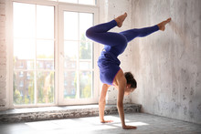 Sporty Woman Practicing Yoga I...