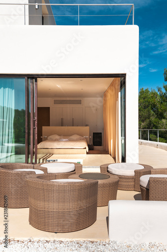 Terrace with circular furniture and modern bedroom