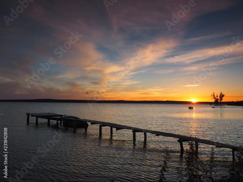 Foto auf AluDibond Pier Sunset. On the big river. Summer. Russia, Ural, Perm region