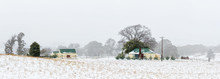 Farm House And Outbuildings In The Snowy Landscape