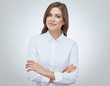 Professional portrait of confident business woman with crossed arms.