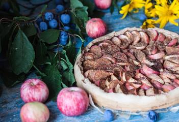 Apple pie on wooden blue rustic