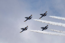 Aerobatic Team Russ On Aircraft L-39 Albatross Performs The Program At The Air Show