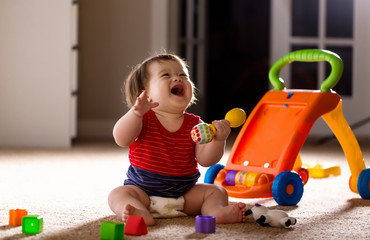 Fototapeta Happy little baby boy playing with his toys