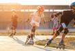 Leinwanddruck Bild - A girl training inline skating with other children