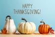 Leinwandbild Motiv Thanksgiving message with pumpkins on a blue background