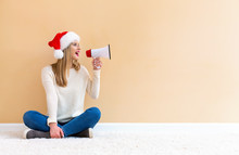 Young Woman With Santa Hat Hol...