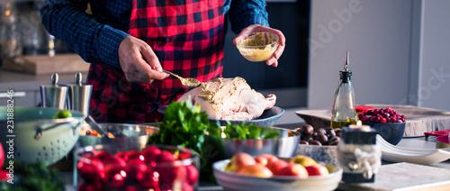 Obraz Man preparing delicious and healthy food in the home kitchen for christmas (Christmas Duck or Goose) - fototapety do salonu