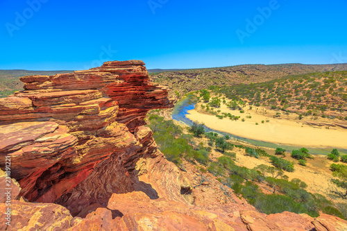 Poster Oceanië The rocks rippled with red and white banded around Nature's Window over Murchison River Gorge in Kalbarri National Park, Western Australia. Popular walk trail in WA.