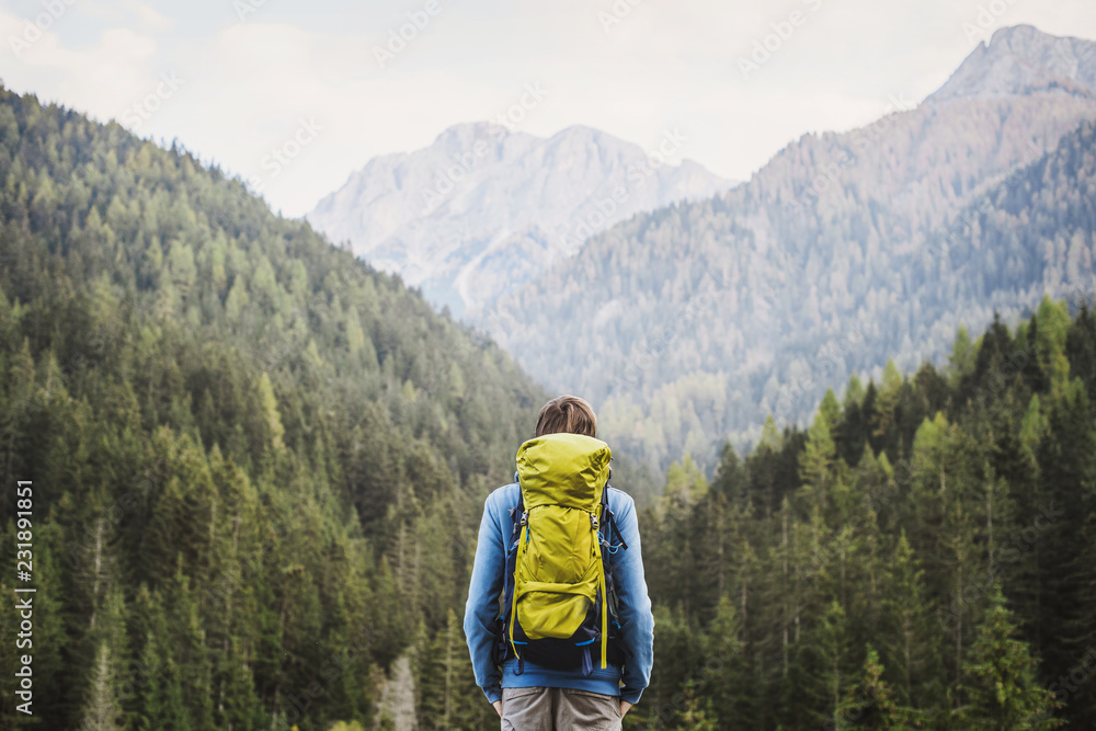 Fototapety, obrazy: Young backpacking man traveler enjoying nature in Alps mountains. Travel and active lifestyle concept.