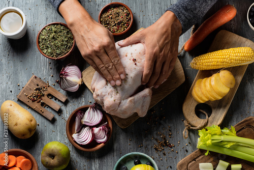young man preparing a turkey