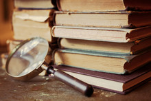 Antique Books With Magnifying Glass.