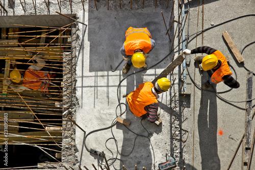 Fényképezés Construction site workers - aerial - Top View