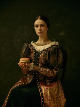 Portrait Of A Girl Wearing A Princess Or Countess Dress Over Dark Studio. Portrait With Burger