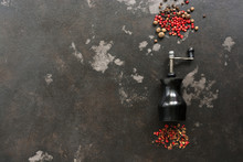 Peppercorns And Pepper Mill On A Dark Rustic Background.Top View, Flat Lay,space For Text.