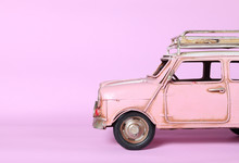 Pink Miniature Car On Pink Background, Insurance Concept