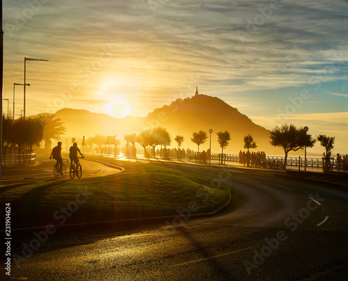 The sun sets behind the Monte Urgull of San Sebastian, Basque Country, Guipuzcoa Fototapet