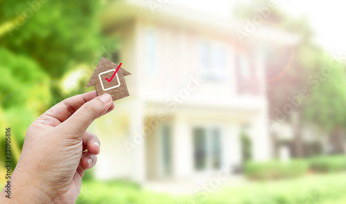 Hand holding brown paper , Home inspection Fotobehang