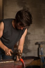 Female Metalsmith Molding Horseshoe In Factory
