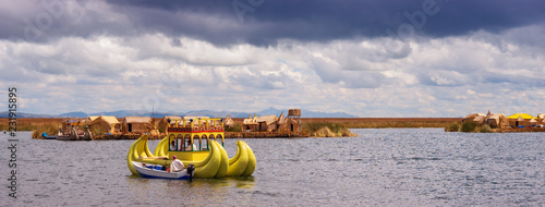 Fotobehang Zuid-Amerika land Traditional village on floating islands on lake Titicaca in Peru