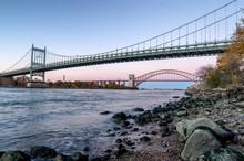 Hell Gate Bridge And Triborough Bridge At Night, In Astoria, Queens, New York. USA