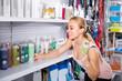 customer choosing shampoo