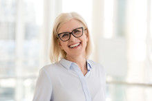 Portrait Of Smiling Middle-aged Businesswoman In Glasses Look In Camera Making Headshot Picture, Happy Mature Female Employee Pose For Picture In Office, Confident Woman Excited For New Opportunities