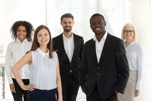 Fényképezés  Portrait of happy diverse work team standing looking at camera motivated for suc