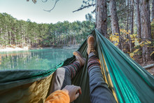 Woman Relaxing In The Hammock By The Lake