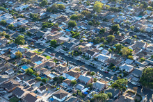 Late Afternoon Aerial View Older San Fernando Valley Residential Streets And Homes Near Van Nuys In Los Angeles, California.