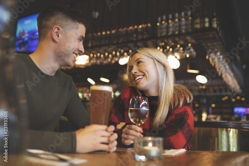 Deurstickers Restaurant Couple having drinks in restaurant