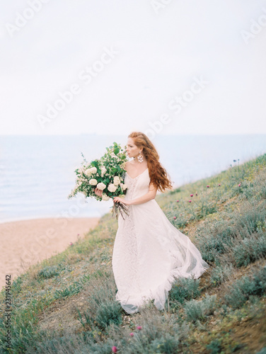 Girl in dress with flowers on beach