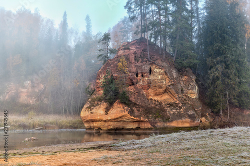 Autumn landscape and red stone cliff of Amata river, Latvia